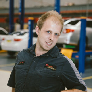 Isaac the motor mechanic at Daniels Automotive head shot photograph