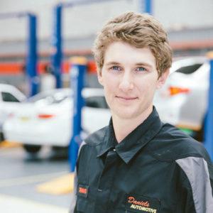 Travis a motor mechanic at Daniels Automotive head shot photograph