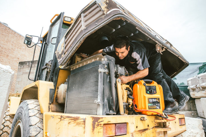 Daniel conducting an onsite emergency repair on a heavy duty vehicle
